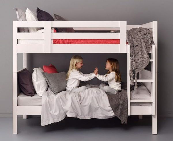 two girls playing on a loft bed